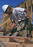 Carpenter assembling wall using pneumatic nailgun