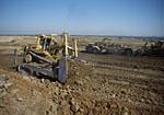 Bulldozer grading slope