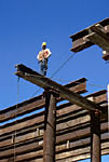 Construction worker standing on steel beam