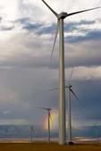 Wind turbines, storm clouds, rainbow