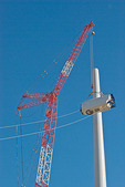 Wind turbine construction: crane lifting cell into position