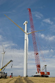 Manitowoc 16000 crawler crane being used to lift wind turbine rotor during wind farm maintenance operation