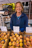 Farmer selling organically grown fruit at farmers' market, downtown Nevada City, California