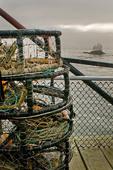 Stacks of crab pots (traps) near commercial fishing harbor, Trinidad, California