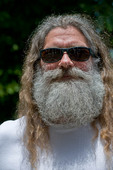 Man with long hair and grey beard outdoors
