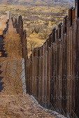 US Border Fence, east of Nogales Arizona USA, constructed autumn and winter of 2008, viewed from US side looking east