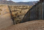 US Border Fence, east of Nogales Arizona USA, constructed autumn and winter of 2008, viewed from US side, note fence following steep hilly terrain.