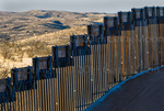 US Border Fence, east of Nogales Arizona USA, constructed autumn and winter of 2008, viewed from US side looking into Mexico.