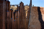 US citizens exploring US Border Fence, east of Nogales Arizona USA, constructed autumn and winter of 2008, viewed from US side looking west.