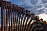 US Border Fence, east of Nogales Arizona USA, constructed autumn and winter of 2008, viewed from US side at dusk.
