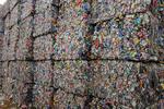 Stacks of bales of crushed aluminum drink cans at metals recycling facility, Tacoma Washington USA