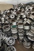 Piles of discarded alloy car wheels at metals recycling facility, Tacoma Washington USA