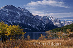 A dusting of snow caps Red Eagle, Mahtotopa & Little Chief mountains--all of which backdrops St. Mary Lake and fall foliage