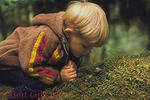 Features of a rain forest attract curiosity of young child