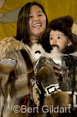 "Carrie Nelson of Point Barrow with son Kyle, who ties for first place in the  ""Authentic Dress"" contest; dressed in baby seal skin. 2009 World Eskimo Indian Olympics; Fairbanks, AK."
