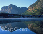 Many Glacier Hotel reflects in Swift Current Lake, Glacier National Park, Montana.
