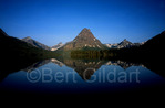 Sinopah Mountain, the center peak in this reflection, is surrounded by many mountains to include Painted Teepee, Lone Walker and Never Laughs. Sinopah was the daughter of Lone Walker, who belonged to a Piegan Indian Tribe known as Never Laughs, and he gave her in marriage to Rising Wolf; Two Medicine Valley, Glacier National Park, Montana. USA