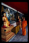 Bhuddist Monk and Holy relics.  Doi Suthep Temple.  Chang Mai. Northern Thailand.