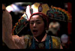 Young Tibetan doing a traditional dance that portrays an historic story.  Summer Palace, Lhasa, Tibet
