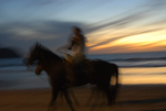 Horseback Riding at dusk, Beach Maztlan, Mexico