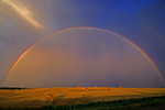Rainbow and bales during storm