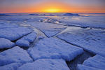 Ice on shore of Lake Winnipeg in spring at sunrise