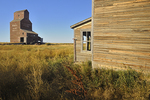 Grain elevator and old building in ghost town