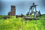 Grain elevator and farm equipment in ghost town