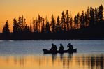 Canoeing on Astotin Lake at sunset