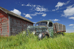 Old International truck and wodden grainery on farm
