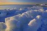 Ice on shore of Lake Winnipeg at sunrise