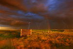 Lightning strikes, rainbow and setting sun during prairie storm. West Block