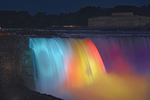Lights illuminating Niagara Falls at night