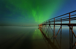 Northern lights (aurora borealis) reflected in Lake Winnipeg