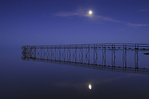 Pier and moon reflected in Lake Winnipeg