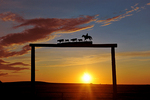 Ranch gate at sunset