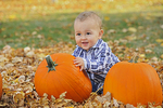 Baby boy with pumpkins