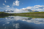 Clouds and Rocky Mountains reflected in Herbert Lake