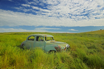 Old Vauxall car in field in ghost town