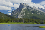 Canoeing on Vermillion Lakes in the Rocky Mountains. Mt Rundle.