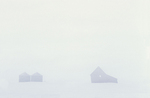 Old farmhouse and graneries in whiteout