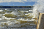 Waves crash on shore of Waskasiu Lake during very windy day