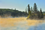 Fog rising off the Bird River at sunrise in boreal forest