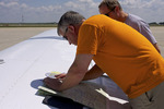 Pilots Work on Flight Plan on Wing of Piper Arrow III Aircraft at Southern Wisconsin Regional Airport in Janesville Wisconsin   819967