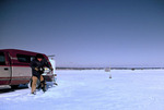 Ice Fisherman Augers Hole in Ice for Fish Shack on Little Bay de Noc at Gladstone Michigan   61547