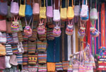 Colorful bags on display in a Guatemalan market.