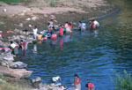 Women washing clothes in Lake Atitlan in the highlands of Guatemala