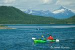 Two people kayaking in Pleaure Bay, Frederick Sound, Alaska