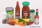 Assorted chili peppers and chili pepper products / foods on a white background