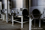 Row of stainless steel wine storage tanks at Stags Leap Winery.